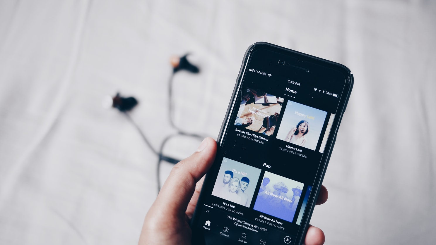 A mobile phone with a music app opened.